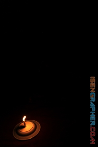 photo 1 : a candlelight in the dark