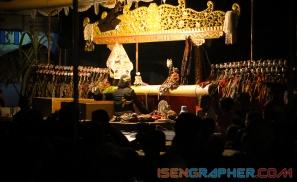 the master of wayang (dalang) playing wayang